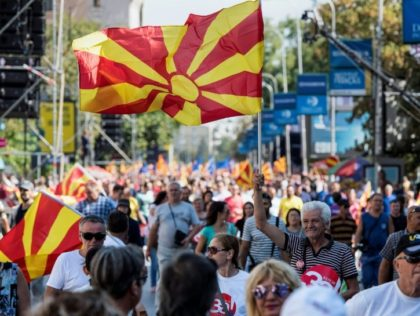 "People wave Macedonian flags at a ""yes"" campaign rally in Skopje ahead of the referendum on whether to change the country's name to ""Republic of Northern Macedonia"""