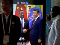 African delegates walk by a screen panel showing a footage of Chinese President Xi Jinping with Ethiopia's Prime Minister Abiy Ahmed ahead of the Forum on China-Africa Cooperation in Beijing, Monday, Sept. 3, 2018. African leaders will likely press their Chinese hosts at a conference this week to help narrow …