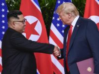 In this June 12, 2018 file photo, North Korea leader Kim Jong Un and U.S. President Donald Trump shake hands at the conclusion of their meetings at the Capella resort on Sentosa Island in Singapore. The newly appointed U.S. special envoy for North Korea will make his first diplomatic trip …