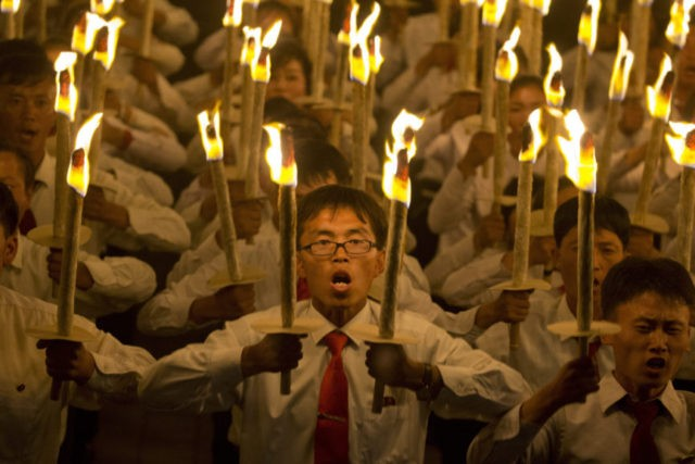 North Korean students take part in a torch light march held in conjunction with the 70th anniversary of North Korea's founding day celebrations in Pyongyang, North Korea, Monday, Sept. 10, 2018. (AP Photo/Ng Han Guan