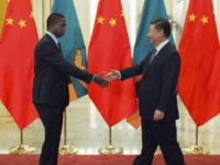 Zambia's President Edgar Lungu, left, shakes hands with China's President Xi Jinping, prior to their bilateral meeting at the Great Hall of the People, in Beijing, China, Sept. 1, 2018. Some are expressing concerns that Beijing is pursuing debt-trap diplomacy vis-a-vis African countries.