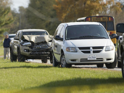 Emergency personnel responded to a scene of a collision that killed three children crossing SR 25 as they were boarding their school bus north of Rochester, Indiana on Tuesday, Oct. 30, 2018,. (Santiago Flores / AP)