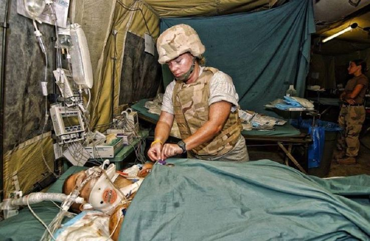 Airman Brian Kolfage receiving treatment after being wounded in combat, losing three limbs