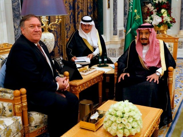 Saudi Arabia's King Salman (R) meets with US Secretary of State Mike Pompeo in Riyadh on October 16, 2018. - Pompeo arrived in the Saudi capital for talks with King Salman on what happened to missing journalist Jamal Khashoggi. (Photo by LEAH MILLIS / POOL / AFP) (Photo credit should …