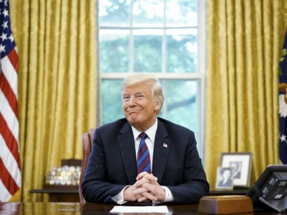US President Donald Trump smiles during a phone conversation with Mexico's President Enrique Pena Nieto on trade in the Oval Office of the White House in Washington, DC on August 27, 2018. - President Donald Trump said Monday the US had reached a 'really good deal' with Mexico and talks …