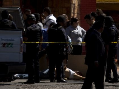 A man lies dead on the street after being shot by city police in Tijuana, Mexico. (AP File Photo/Guillermo Arias)