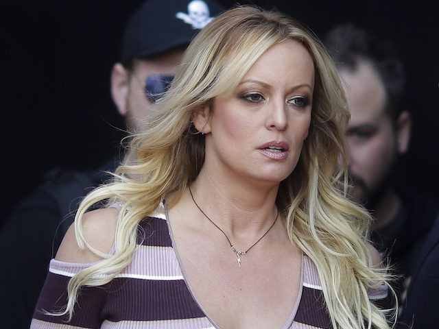 Adult film actress Stormy Daniels, front, arrives for the opening of the adult entertainment fair 'Venus' in Berlin, Germany, Thursday, Oct. 11, 2018. (AP Photo/Markus Schreiber)