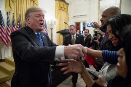 President Donald Trump greats members of the audience after speaking at the 2018 Young Black Leadership Summit in the East Room of the White House, Friday, Oct. 26, 2018, in Washington. (AP Photo/Andrew Harnik)