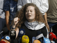 Ahed Tamimi speaks during a press conference on the outskirts of the West Bank village of Nabi Saleh near the West Bank city of Ramallah, Sunday, July 29, 2018. Palestinian protest icon Ahed Tamimi and her mother Nariman returned home to a hero's welcome in her West Bank village on …