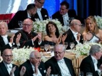 Keynote speaker Ambassador to the United Nations Nikki Haley, center, shares a light moment as she attends the 73rd Annual Alfred E. Smith Memorial Foundation Dinner Thursday, Oct. 18, 2018, in New York. Left center is Archbishop of New York Cardinal Timothy Dolan, and right center is Michael Haley, husband …