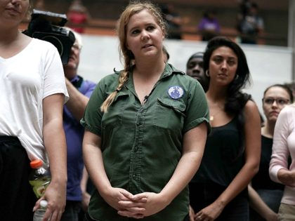 WASHINGTON, DC - OCTOBER 04: Comedian Amy Schumer (C) participates in a protest against the confirmation of Supreme Court nominee Judge Brett Kavanaugh October 4, 2018 at the Hart Senate Office Building on Capitol Hill in Washington, DC. Senators had an opportunity to review a new FBI background investigation into …