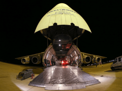 Members of the Bundeswehr, the German armed forces, load an Antonov 124 cargo plane with food and other humanitarian aid destined for Erbil in northern Iraq at the airport Leipzig-Halle on August 22, 2014 in Schkeuditz, Germany. German leaders recently announced they will begin sending weapons as well in order …