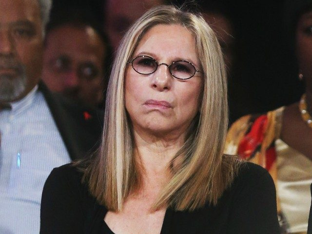 NEW YORK, NY - SEPTEMBER 25: Singer Barbra Streisand listens as Egyptian President Mohamed Morsi speaks at the Clinton Global Initiative meeting on September 25, 2012 in New York City. Timed to coincide with the United Nations General Assembly, CGI brings together heads of state, CEOs, philanthropists and others to …