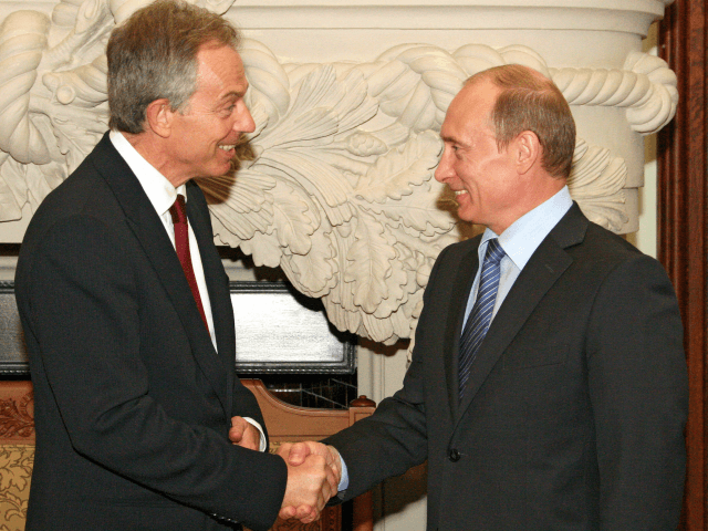 Russian Prime Minister Vladimir Putin (R) shakes hands with former Prime Minister of Britain Tony Blair in Moscow on June 16, 2008. Putin and Blair met amid the continuing investors row between in the joint British-Russian oil company TNK-BP. AFP PHOTO / RIA NOVOSTI / POOL / SERGEY SUBBOTIN (Photo …