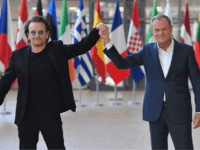 Irish rock band U2 singer Bono (L) poses with European Council President Donald Tusk upon his arrival at the European Council in Brussels on October 10, 2018. - Bono, the co-founder of ONE, a global campaign and advocacy organisation committed to ending extreme poverty, is in Brussels to discuss African …