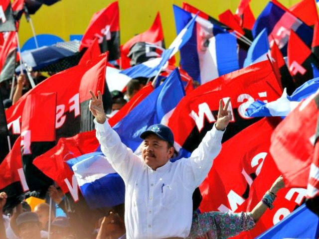 West Palm Beach restaurant owner Dina Rubio, an exile from Nicaragua, argues that the socialist uprising led by Sandinista leader Daniel Ortega (pictured at Managua rally in September), quickly led to the loss of individual rights and a moribund economy.