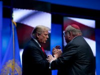 President Donald Trump talks with Rabbi Benjamin Sendrow after he prayed at the 91st Annual Future Farmers of America Convention and Expo at Bankers Life Fieldhouse in Indianapolis, Saturday, Oct. 27, 2018, following a shooting in a Pittsburg synagogue. (AP Photo/Andrew Harnik)