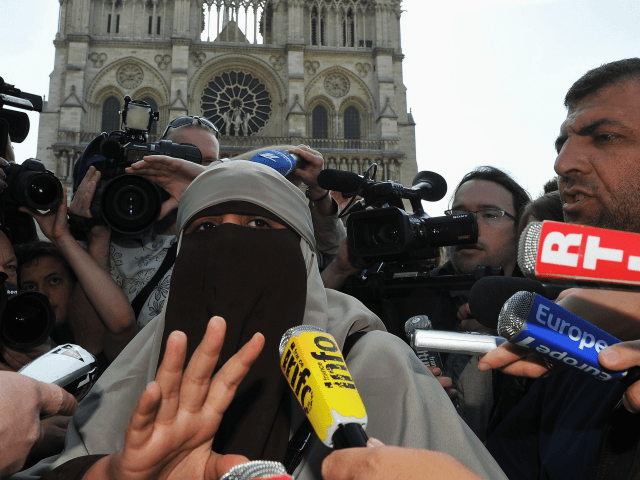 PARIS, FRANCE - APRIL 11: Kenza Drider addresses the media as she demonstrates against the ban of the 'niqab' or full-face veil in public places, on April 11, 2011 in Paris, France. An official ban on wearing the niqab or burka came into effect in France from first thing this …