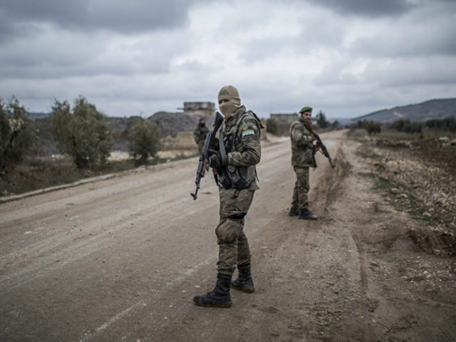 Turkey-backed Free Syrian Army fighters secure an area where the Turkish army's Operation Olive Branch continues in Azaz, northwestern Syria, Wednesday. (AP)