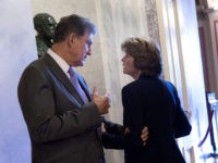 WASHINGTON, DC - AUGUST 23: Sen. Lisa Murkowski (R-AK) (R) talks with Sen. Joe Manchin (D-WV) in the halls of the U.S. Capitol August 23, 2018 in Washington, DC. Later in the day, Murkowski is scheduled to meet with Judge Brett Kavanaugh, President Donald Trump's pick to replace the retiring …