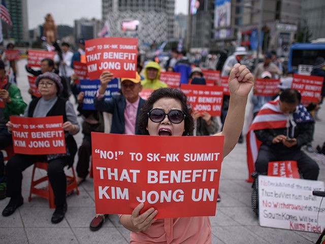 Anti-North Korean activists attend a protest against the inter-Korean summit, in Seoul on September 20, 2018. - Kim Jong Un and Moon Jae-in visited the spiritual birthplace of the Korean nation for a show of unity after their North-South summit gave new momentum to Pyongyang's negotiations with Washington. (Photo by …