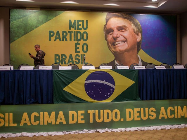 A journalist watches Brazilian presidential candidate for the Social Liberal Party (PSL) Jair Bolsonaro on Facebook live as he didn't show up at the hotel where he was expected to deliver a press conference in Barra da Tijuca, Rio de Janeiro, Brazil, on October 7, 2018, during general elections. - …