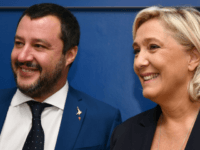 Italy's Interior Minister, Matteo Salvini (L) and leader of France's far-right National Rally (RN) party, Marine Le Pen arrive to hold a press conference within a meeting on the theme 'Economic growth and social prospects in a Europe of Nations' on October 8, 2018 at the headquarters of the Unione …