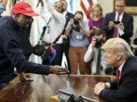 WASHINGTON, DC - OCTOBER 11: (AFP OUT) Rapper Kanye West , left, shows a picture of a plane on a phone to U.S. President Donald Trump during a meeting in the Oval office of the White House on October 11, 2018 in Washington, DC. (Photo by Oliver Contreras - Pool/Getty …
