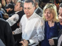 US pastor Andrew Craig Brunson (C,L) arrives at Adnan Menderes airport in Izmir, on October 12, 2018 after being freed following a trial in a court in Aliaga in western Izmir province. - US pastor Andrew Brunson, freed after a two-year detention in Turkey that shook relations between the countries, …