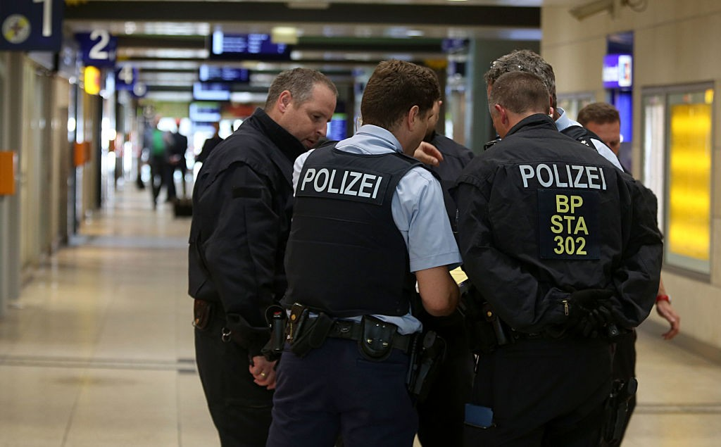 Police officers stand in positions in the Central Station in Cologne western Germany