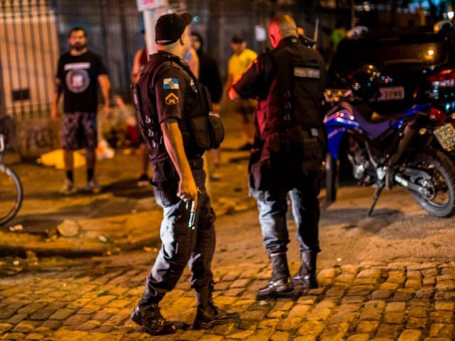 Brazilian riot police scatter supporters of the far right-wing Brazilian President elect Jair Bolsonaro and supporters of left wing professor and presidential candidate for the Workers Party (PT), Fernando Haddad, on a turmoil after Jair Bolsonaro won the election in a pro-Haddad demonstration in Rio de Janeiro on October 28, …