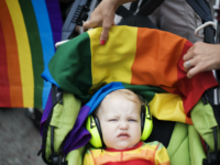 A child wearing ear protection gear attends the HBTQ festival 'Stockholm Pride' parade on August 6, 2011 in central Stockholm. AFP PHOTO / JONATHAN NACKSTRAND (Photo credit should read JONATHAN NACKSTRAND/AFP/Getty Images)