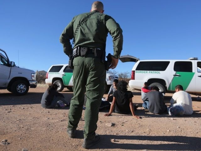 Border Patrol agents arrest migrants in Arizona after they illegally crossed the border from Mexico.