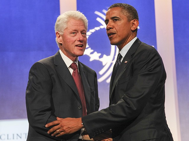 NEW YORK - SEPTEMBER 24: Former U.S. President Bill Clinton (L) greets U.S. President Barack Obama on stage during the annual Clinton Global Initiative (CGI) meeting on September 24, 2013 in New York City. Timed to coincide with the United Nations General Assembly, CGI brings together heads of state, CEOs, philanthropists and others to help find solutions to the world's major problems. (Photo by Allan Tannenbaum-Pool/Getty Images)