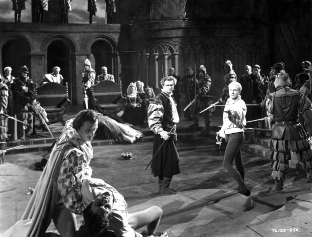 1948: English actor, producer and director Laurence Olivier (1907-1989) playing Hamlet in his film version of Shakespeare's work. He is involved in a sword fight with Laertes, played by Terence Morgan, watched by Norman Wooland as Horatio. (Photo by Wilfrid Newton/Hulton Archive/Getty Images)