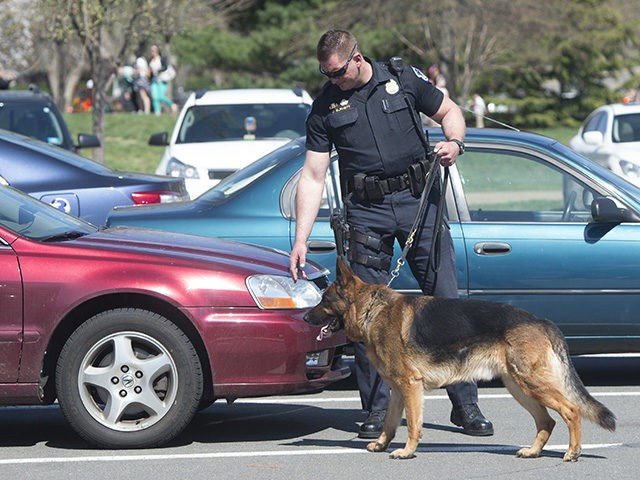 US Capitol Police use a bomb sniffing dog at a parking lot as they respond to reports of a shooting at the US Capitol in Washington, DC, April 11, 2015. Shots were fired near the steps of the US Capitol Saturday leading to a lockdown of the building, police said, …