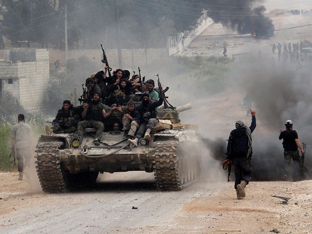 Fighters from a coalition of Islamist forces celebrate on May 19, 2015 after taking the Al-Mastumah base in the Syrian city of Idlib, the second provincial capital to fall from government control. The capture is a blow to the Syrian regime and raises the prospect that the city will become …