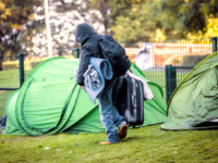 A man moves out his belonging from the Maximilien park where refugees build an improvised camp awaiting their demand to be registered as an asylum seeker being handled, near the immigration office which is the agency for the reception and the first contact for asylum seekersm on October 1 2015 …