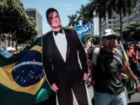 A protester carries a life-size image of Brazilian Federal Judge Sergio Moro, who conducts the Lava Jato (Car wash) operation, the biggest corruption investigation in Brazil's history, during a public servants' demonstration against austerity measures in front of the Rio de Janeiro state Assembly (ALERJ), in Rio de Janeiro, Brazil, …