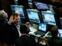 NEW YORK - OCTOBER 01: A trader smiles gestures another for a high-five on the floor of the New York Stock Exchange October 1, 2007 in New York City. Today the Dow Jones industrial average reached an all time intraday high of 14,115.51 before a record closing of 14,087.55. (Photo …