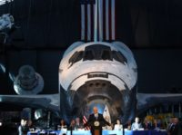 "CHANTILLY, VA - OCTOBER 05: The Space Shuttle Discovery is the back drop as Vice President Mike Pence speaks during the inaugural meeting of the National Space Council on ""Leading the Next Frontier"" at the National Air and Space Museum, Steven F. Udvar-Hazy Center, October 5, 2017 in Chantilly, Virginia. …"