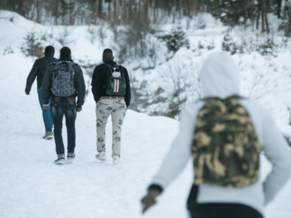 Migrants walk in the snow on their way to the Colle della Scala (Col de l'Echelle) a snow-covered pass to cross the border between Italy and France, on January 13, 2018 near Bardonecchia, Italian Alps. / AFP PHOTO / Piero CRUCIATTI (Photo credit should read PIERO CRUCIATTI/AFP/Getty Images)