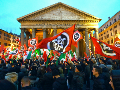 Activists of Casapound, a far right movement turned political party, wave flags during an election campaign meeting at the Pantheon square in Rome on March 1, 2018. / AFP PHOTO / Andreas SOLARO (Photo credit should read ANDREAS SOLARO/AFP/Getty Images)