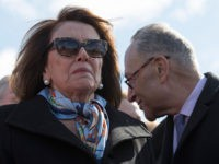 "House Minority Leader Nancy Pelosi (L), D-California, and Senate Minority Leader Chuck Schumer (R), D-New York, speak to students from DC, Maryland and Virginia during a rally in their Solidarity Walk-Out to urge Republican leaders in Congress ""to allow votes on gun violence prevention legislation"" on Capitol Hill in Washington, …"