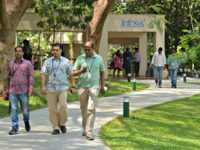Employees of Infosys Technologies Limited walk in the campus of the company's headquarters in Bangalore on April 13, 2017. Indian software giant Infosys has pledged to return USD2 billion to shareholders this year as it reported subdued growth in profits for the fourth quarter.
