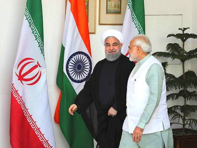 Indian Prime Minister Narendra Modi, right, talks with Iranian President Hassan Rouhani, as they arrive for their delegation level meeting in New Delhi, India, Saturday, Feb. 17, 2018. Rouhani, who is on three days state visit to India has strongly criticized the Trump administration's recognition of Jerusalem as Israel's capital …