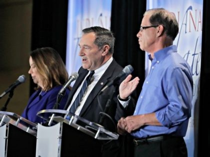 Democratic Sen. Joe Donnelly, middle, speaks duirng a U.S. Senate Debate against Republican former state Rep. Mike Braun and Libertarian Lucy Brenton, Monday, Oct. 8, 2018, in Westville, Ind.