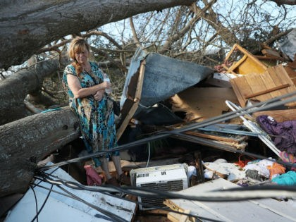 Kathy Coy stands among what is left of her home after Hurricane Michael destroyed it on October 11, 2018 in Panama City, Florida. She said she was in the home when it was blown apart and is thankful to be alive. The hurricane hit the Florida Panhandle as a category …