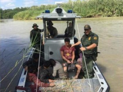 Laredo Sector Border Patrol agents rescue ten illegal aliens who had been stranded on an island in the Rio Grande River by human smugglers. (Photo: U.S. Border Patrol/Laredo Sector)