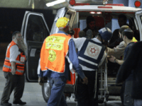 ISRAEL OUT A wounded man is wheeled into a hospital in Jerusalem following a shooting attack on a religious school in the city in which at least eight students were killed on March 6, 2008. Some 35 people were wounded in the attack on the Merkaz Harav Yeshiva in the …